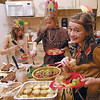 Let's eat: Consolidated Elementary School fifth grade students Chloee Hurst, Hannah Davidson and Natalie Mauk prepare their plates during Tuesday's Thanksgiving dinner.