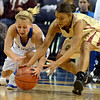 Tribune-Star/Jim Avelis<br /> On the loose: Indiana State guard Brittany Schoen grapples for a loose ball with IUPUI guard Emily Phillips in first half action Tuesday night in Hulman Center.