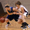 Tribune-Star/Jim Avelis<br /> Never easy: ST. Mary-of-the-Woods guard Alaura McKemie and Rose-Hulman forward Jaci Dalton fight for a loose ball in first half action Tuesday night on the Engineers' floor.