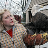 Tribune-Star/Jim Avelis<br /> Amputee: Dale Stokes holds Atsu Yazhi, a bald eagle. The bird was found wounded by gunshot with infection so advanced the wounded wing had to be amputated.