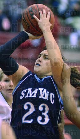 Tribune-Star/Jim Avelis<br /> Concentration: St. Mary-of-the-Woods guard Chelsey Barron gets fouled as she attempts a shot in the Pomeroy's game with Rose-Hulman.