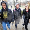 Tribune-Star/Jim Avelis<br /> Frightful: Indiana State University freshmen Jalen Brower, Natalie Mitchell and Caitlin Allen walk from class in the first snow of the season Tuesday afternoon.