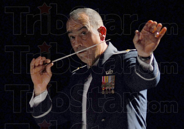 Leader: Major R. Michael Mench directs the United States Air Force Band of Flight Tuesday night at Terre Haute South.
