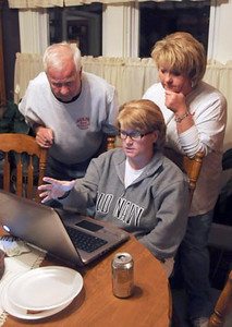 Tribune-Star/Joseph C. Garza<br /> The numbers start to come in: Amy Auler, right, candidate for city council district 1, looks at election results on the web with her father, Larry Auler, left, and friend, Theresa Straw, Tuesday evening at Larry's home.