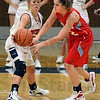 Tribune-Star/Jim Avelis<br /> Defense: Terre Haute north guard Morgan Stewart deflects a pass by Turkey Run's Abby Aubrey in early action Tuesday night on the Patriot's floor.