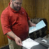 Tribune-Star/Jim Avelis<br /> Noble task: John Noble watches his ballot slide into the voting machine at Collett Park as he casts his vote Tuesday.