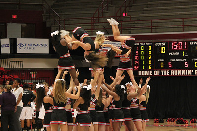GWU Cheerleaders perform a stunt during a time out