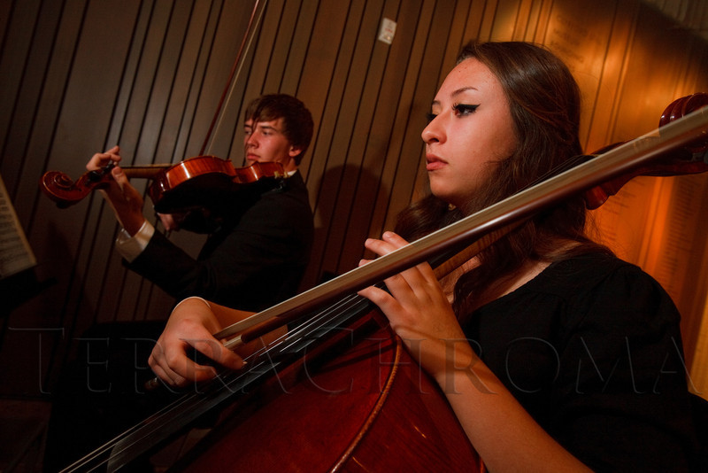 Denver School of the Arts students Ethan Durell (14) plays viola, and Addy Harris (16) plays cello, as part of a quartet in the lobby area.  Grand opening celebration of the Clyfford Still Museum at the Clyfford Still Museum in Denver, Colorado, Wednesday, Nov. 16, 2011.  Photo Steve Peterson, Special to the Denver Post