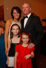 Stephanie and Rod Linafelter with their daughters, Alexis (a 2009 Sugarplum) and Grace (front).  Presentation of the 2011 Sugarplums during the 2011 Sugarplum Ball, presented by the Colorado Ballet Auxiliary, at the Brown Palace Hotel & Spa in Denver, Colorado, on Friday, Nov. 25, 2011.<br /> Photo Steve Peterson