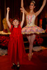 Julia Cole demonstrates to studio company member of the Colorado Ballet, Charlotte Lanning, how to go en pointe.  Presentation of the 2011 Sugarplums during the 2011 Sugarplum Ball, presented by the Colorado Ballet Auxiliary, at the Brown Palace Hotel & Spa in Denver, Colorado, on Friday, Nov. 25, 2011.<br /> Photo Steve Peterson