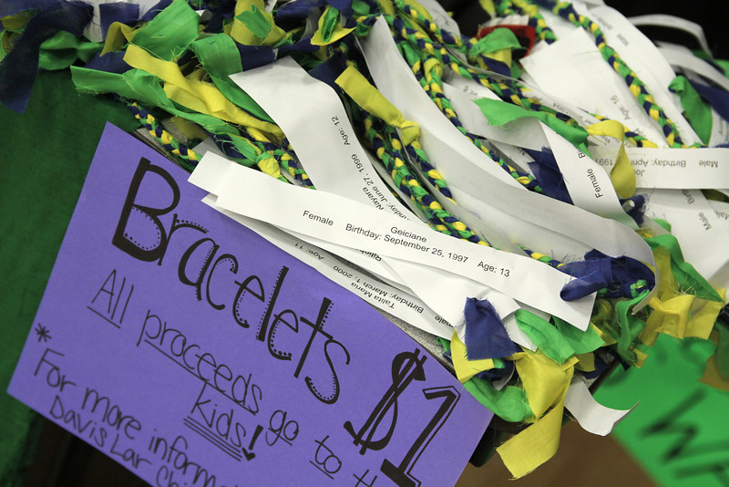 At Fields of Faith, there was a table set up for the Davis Lar Children's Home to inform students and to sell prayer braclets.