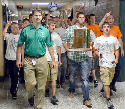 Dead man walking: West Vigo principal Tom Balitewicz (L) is escorted to the gymnasium by the sectional winning boys soccer team where he received a haircut by members of the team.