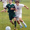 Tribune-Star/Jim Avelis<br /> No quit: West Vigo's Andrew Kump(8) battles a bigger Jon Good of Greencastle for control of the ball late in the first half of their sectional soccer matchup Thursday evening on the Tiger Cub's field.