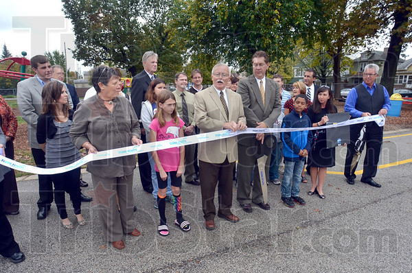 Ribbon cutting: Donors, dignitaries and students gather for the ribbon cutting opening of the Fitness Trail at Davis Park Elementary School Thursday afternoon.
