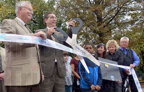 Cut: Mayor Duke Bennett cuts the ribbon for the dedication of the Fitness Trail at Davis Park Elementary School Thursday afternoon.