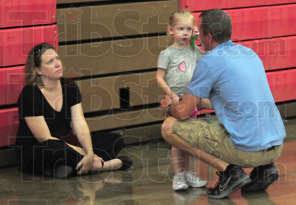 Family affair: Marshall volleyball coach Mike Farrell visits with his daughter Molly and wife Becky during Wednesday's practice at the school.