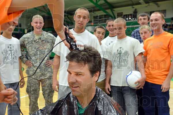 Buzzed: West Vigo principal Tom Balitewicz gets buzzed by members of the sectional champion soccer team Thursday afternoon.