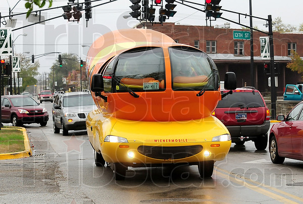 Tribune-Star/Joseph C. Garza<br /> Weiner about town: Oscar Mayer Hotdogger Kylie Hodges drives the Weinermobile through the 12 Points intersection on her way to the north Kroger's Thursday.