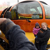 Tribune-Star/Joseph C. Garza<br /> Can't help but smile: Heather Doscher holds one-year-old Ahlaya Richardson as they pose for a photo in front of the Oscar Mayer Weinermobile in the Kroger's parking lot Thursday on Wabash Avenue.