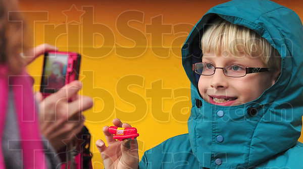 """Tribune-Star/Joseph C. Garza<br /> His """"wurst"""" whistle: Nine-year-old Johnathon Revell poses for a photo with a miniature Weinermobile whistle in hand during his visit to the Kroger's on Wabash Avenue to see the link shaped auto Thursday."""