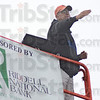 Tribune-Star/Jim Avelis<br /> Backers: Bob Medworth directs his band from atop a scissors lift. The community backs the band's efforts with financial suport.