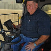 Tribune-Star/Jim Avelis<br /> GPS enabled: Larry Burnett is able to watch the grain head on his combine more closely due to the satellite-guided steering system.