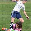 Tribune-Star/Jim Avelis<br /> Not this time: Terre Haute North forward Amanda Loebker steps over Owen Valley goal keper Georgie Macy in a thwarted attempt to add to the Patriot's total.