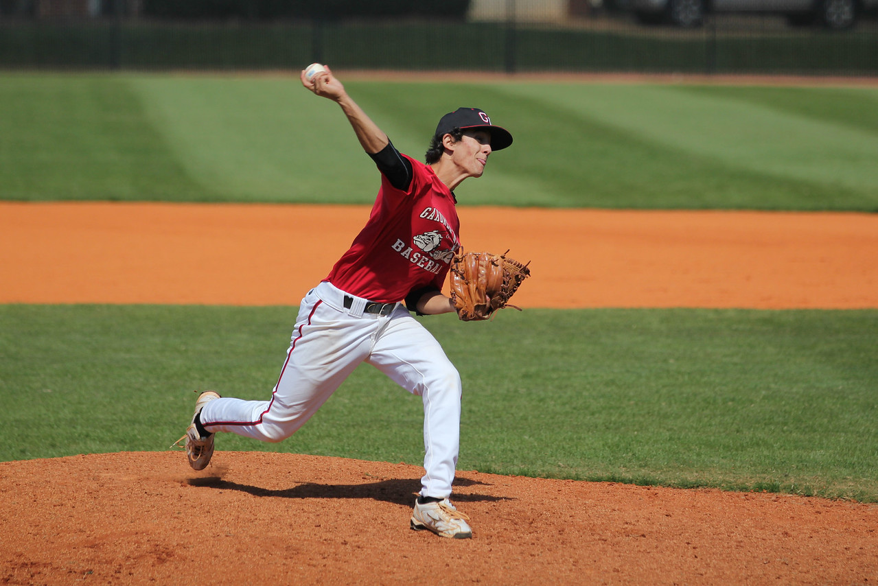 Henry Rundio, 9, first father son pitching experience in GWU history.