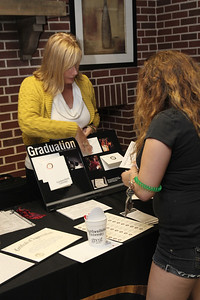 Students check out graduation announcements.