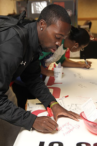 Marquis Sanders signs the Class of 2011 banner.