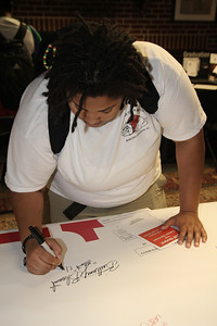 Brittany Blount signs the Class of 2011 banner.