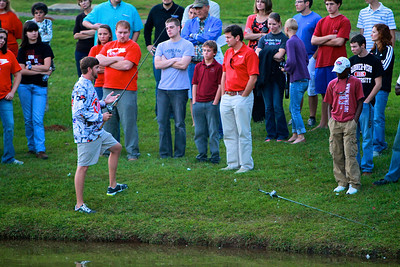 Angler Matt Arey speaks with the GWU Fishing Club and demonstrates good casting techniques at Lake Hollifield.