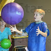 Havin' a ball: Nine-year-old twins Caroline and Peter Christ have a ball during Monday's Columbus Day events at the Terre Haute Children's Museum.