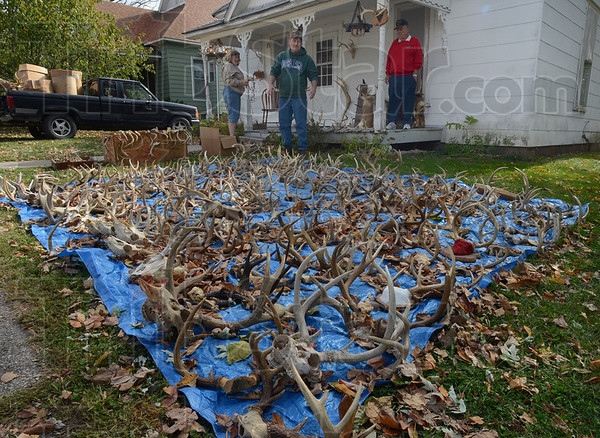 Tribune-Star/Jim Avelis<br /> Bone collector: Richard Wallace, top center, uses his dad's front yard to sell and trade antlers that he has collected and traded for. The senior Richard Wallace lives in Rockville, the center of the the Covered Bridge Festival.