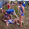 Tribune-Star/Jim Avelis<br /> All in: Indiana State University runner Kelsie Slater(246) is tended to by trainer Heather Adams at the finish of the race Saturday. With her are teammates Kalli dalton and Andrea Prusz.