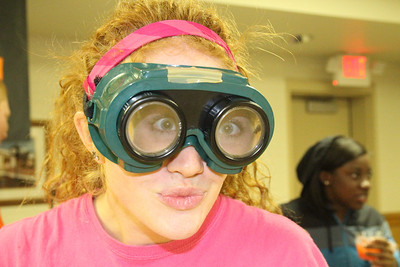 """Students put """"beer goggles"""" on to walk the line at OctSOBERfest."""