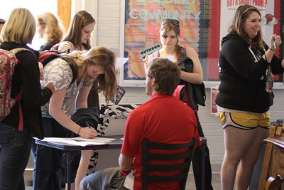 Students sign up for the Women's Powder Puff game.