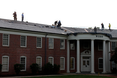 The workers construct the roof of Webb Hall.