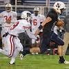 Tribune-Star/Jim Avelis<br /> Room to roam: Terre Haute North quarterback Brian Gehrich runs for a long gain early in the Patriot's MIC game with Lawrence North. Defending on the play is Wildcat Timdrick Stewart.