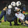 Tribune-Star/Jim Avelis<br /> Wildcat sandwich: Terre Haute North defenders including Wyatt Stoelting, Vasco Bilberry and  Austin Lewis bring down Lawrence North quarterback Matthew Hinshaw in first quarter action Friday night on the Patriot's field.