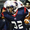 Tribune-Star/Jim Avelis<br /> Room to run: Terre Haute North running back Kai Stratten finds an opening in the North Central defense.
