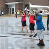 Tribune-Star/Jim Avelis<br /> Run for cover: The Terre Haute North marching band drum line heads indoors as the rain strengthens Thursday evening. The brass section and flag bearers kept practicing through the precipitation and cool winds.
