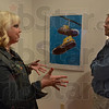 Tribune-Star/Jim Avelis<br /> Let's talk: Photographer Samantha McGranahan chats with artist Neil Garrison at the Gopolan Gallery where their shows opened Friday evening.