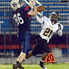 Almost: North's #86 Calvin Blank has a pass stripped away during action against Avon Friday evening. Defending for Avon is #21 Devyn Mikell.