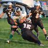 Tribune-Star/Jim Avelis<br /> Tough yards: West Vigo's Logan Meissel(20) finds the going tough against Northview defenders Tyler Wilson(15), Connor Bowman(14) and Jed Thomas(6).