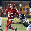 Escape: Marshall quarterback #22, Jacob Duncan looks downfield for a receiver during action against Casey-Westfield.