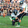 Tribune-Star/Jim Avelis<br /> First three: West Vigo placekicker Nathan Gregg hit his first attempt at a field goal Friday night. Holder is Chris Neidlinger.