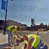 Tribune-Star/Jim Avelis<br /> Corner work: Gary Jones and Gary Hedges of ST Construction set handicap pavers at the corner of 13th and Wabash Friday afternoon. The project includes replacing the streetlights with new, more stylish ones.