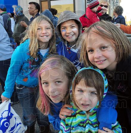Take our picture: A group of young kids ask to have their picture taken during the ISU Homecoming parade Saturday morning in cool temperatures along Wabash Avenue.