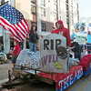 American tradition: Indiana State University Greeks  ride a float during the annual Homecoming Parade.